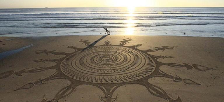 Sand artist uses the shoreline as a canvas