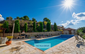 12.2m x 4.3m swimming pool with walk-in steps. Solar heating available in the cooler months