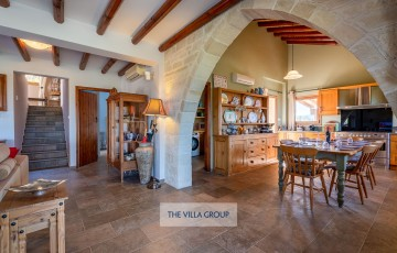 Stone archway leads to the fully equipped kitchen