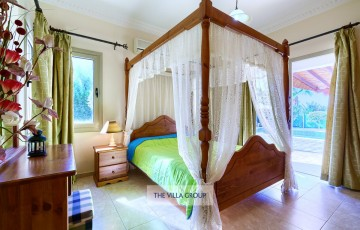 The first of the bedrooms; a four poster bed is located on the ground floor