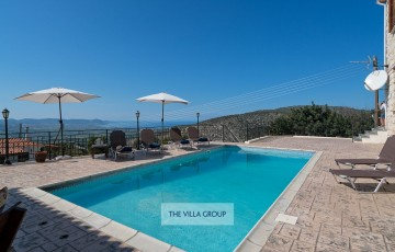 Private swimming pool and terrace with beautiful countryside and distant sea views