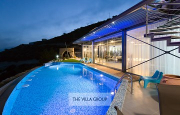 Villa lit during the evening