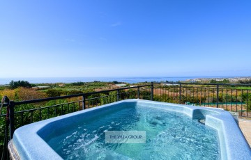 Relax in the hot tub and enjoy the views