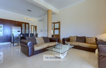 The ground floor offers 2 living rooms with comfortable sofas